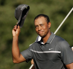 In this Aug. 21, 2015, file photo, Tiger Woods tips his hat to the crowd after finishing his round on the 18th hole during the second round of the Wyndham Championship golf tournament in Greensboro, N.C. (AP/Chuck Burton)