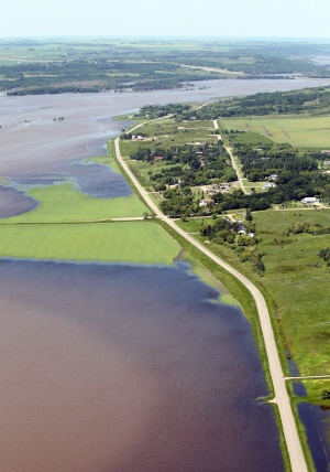 Flood water from the swollen Assiniboine River covers farm land along Grand Valley Road west Brandon, Man.on Sunday, July 6, 2014. (Tim Smith/THE CANADIAN PRESS)