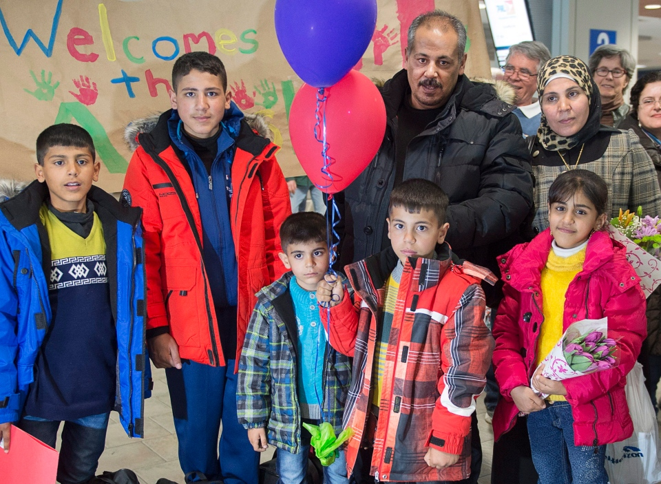 The Ayash family from Syria pose for a photograph as they arrive at the airport in Halifax on Monday, February 29, 2016. The family is being sponsored by a community group in Lunenburg, N.S. and will soon move into their new home in the historic town. (THE CANADIAN PRESS/Andrew Vaughan)