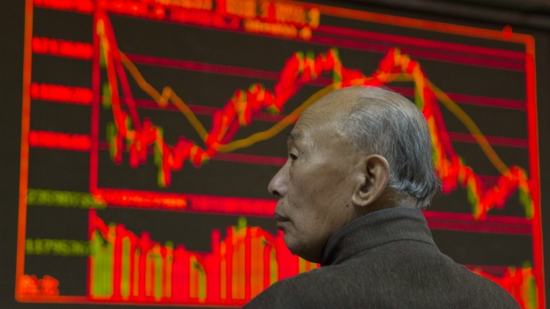Global Stocks Slide on China Currency Concerns