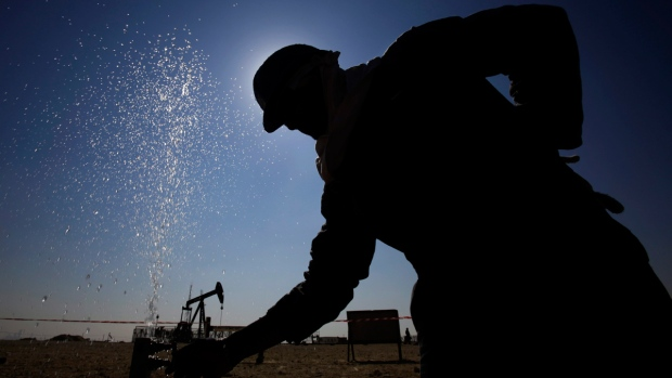 An oil worker in the desert oil fields of Bahrain