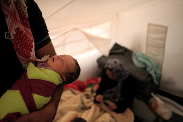 Baby in Syrian refugee camp in Jordan