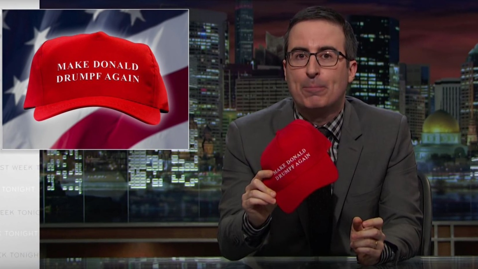 "Comedian John Oliver shows off his ""Make Donald Drumpf Again"" hats on HBO's Last Week Tonight, on Sunday, Feb. 28, 2016."