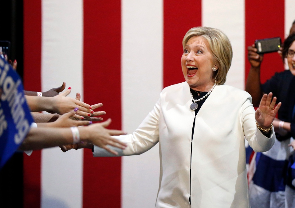 Democratic presidential candidate Hillary Clinton reacts to supporters as she arrives at her Super Tuesday election night rally in Miami, Tuesday, March 1, 2016. (AP / Gerald Herbert)