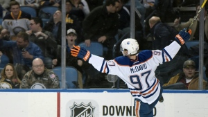 Edmonton Oilers center Connor McDavid celebrates his overtime goal against the Buffalo Sabres in an NHL hockey game in Buffalo, N.Y. on Tuesday, March 1, 2016.  (AP / Gary Wiepert)