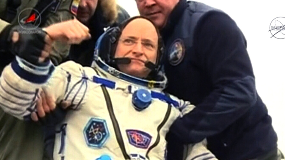 U.S. astronaut Scott Kelly is seen just after being pulled from the capsule after landing back on Earth, Tuesday, March 1, 2016.
