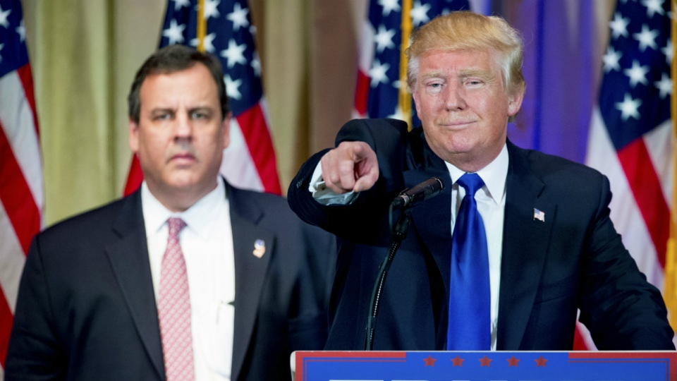 Republican presidential candidate Donald Trump, accompanied by New Jersey Gov. Chris Christie, left, takes questions from members of the media during a news conference on Super Tuesday primary election night in the White and Gold Ballroom at The Mar-A-Lago Club in Palm Beach, Fla. on Tuesday, March 1, 2016. (AP / Andrew Harnik)