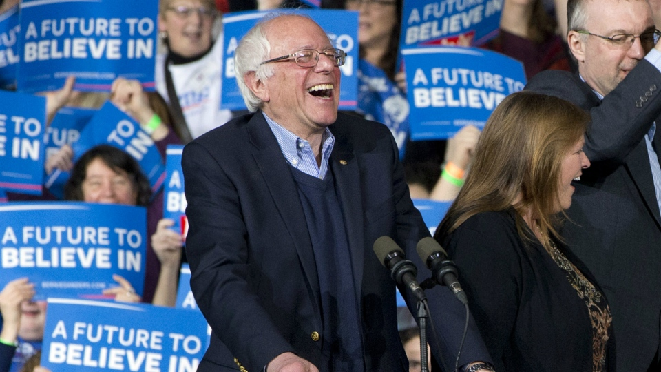 Democratic presidential candidate Sen. Bernie Sanders, I-Vt., laughs as he arrives with his wife Jane Sanders, and his son Levi Sanders to a primary night rally in Essex Junction, Vt. on Tuesday, March 1, 2016. (AP / Jacquelyn Martin)