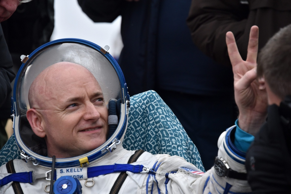 International Space Station (ISS) crew member Scott Kelly of the U.S. shows a victory sign after landing near the town of Dzhezkazgan, Kazakhstan, on Wednesday, March 2, 2016. (Krill Kudryavtsev/Pool photo via AP)