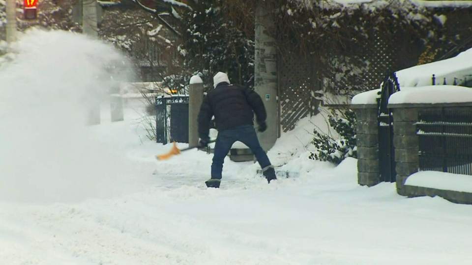 A Toronto resident shovels snow on Wednesday, March 2, 2016.