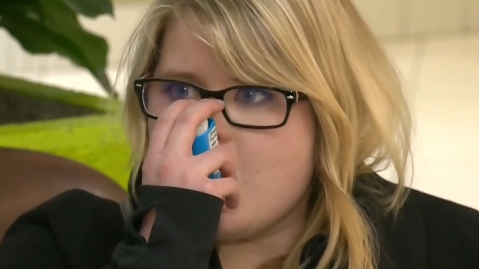 Kate Reid demonstrates her asthma inhaler as she speaks to CTV Calgary about a shortage of the drug Ventolin.