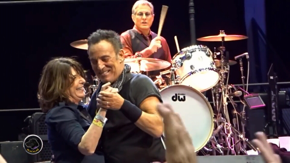 Bruce Springsteen dances with Teri Walderman at a concert in Rochester, N.Y. on Saturday, Feb. 27, 2016.