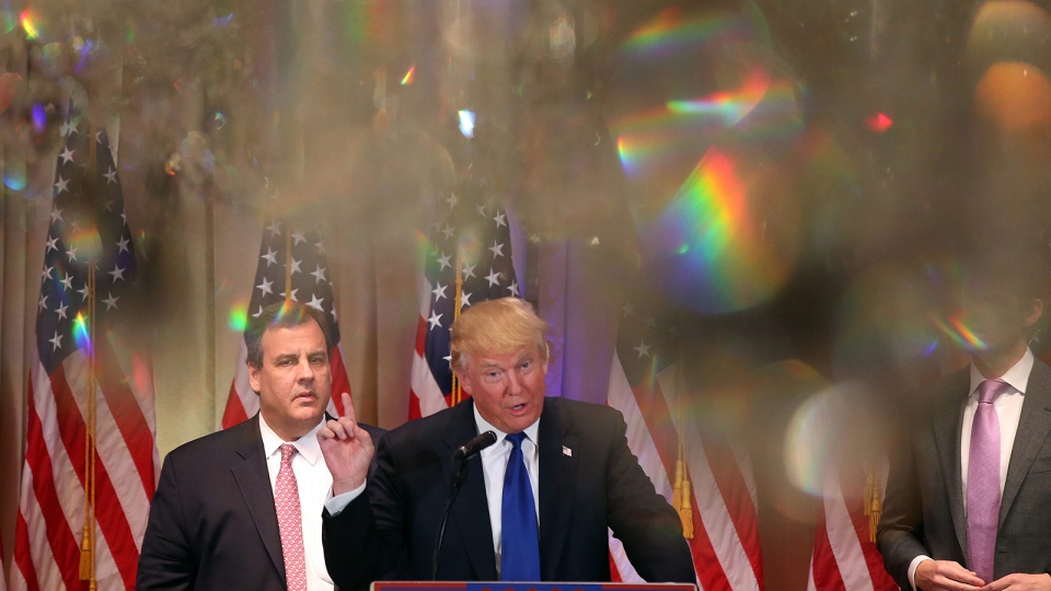 Republican presidential candidate Donald Trump speaks on Super Tuesday primary election night at the White and Gold Ballroom at The Mar-A-Lago Club in Palm Beach, Fla., Tuesday, March 1, 2016, as New Jersey Gov. Chris Christie listens at left. (AP / Andrew Harnik)