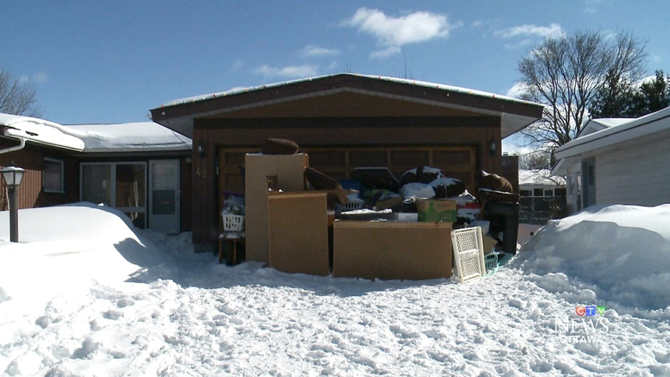A pile of belongings blocks the Pullens' driveway at their Ottawa home on Wednesday, Feb. 3, 2016.
