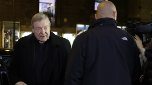Australian Cardinal George Pell, left, arrives at the Quirinale hotel in Rome to testify via videolink from the Rome hotel to the Royal Commission into Institutional Responses to Child Sexual Abuse sitting in Sydney on Wednesday, March 2, 2016. (AP / Gregorio Borgia)
