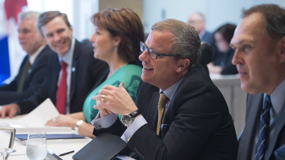 Premiers, left to right, Quebec's Philippe Couillard, New Brunswick's Brian Gallant, British Columbia's Christy Clark, Saskatchewan's Brad Wall and Yukon's Darrell Pasloski attend the Council of the Federation in Vancouver, B.C., Wednesday, March 2, 2016. (Jonathan Hayward / THE CANADIAN PRESS)