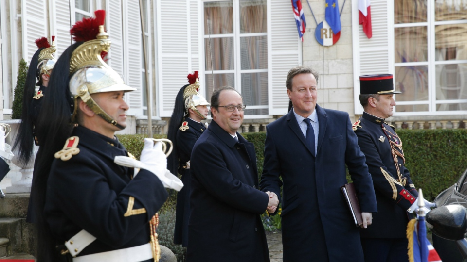 French President, Francois Hollande, left, greets British Prime Minister David Cameron prior to their meeting in Amiens, northern France on Thursday, March 3, 2016. (AP / Christophe Ena)