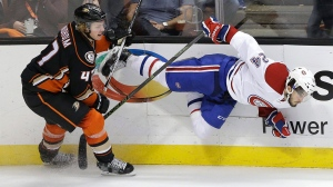 Anaheim Ducks' Hampus Lindholm, left, of Sweden, shoves Montreal Canadiens' Phillip Danault during the third period of an NHL hockey game Wednesday, March 2, 2016, in Anaheim, Calif. (AP / Jae C. Hong)