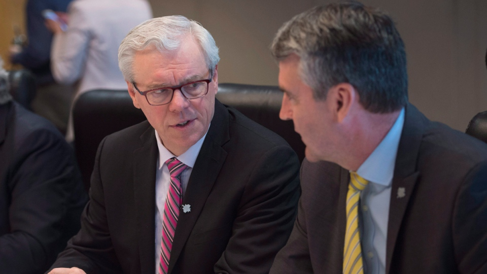 Manitoba Premier Greg Selinger, left, speaks with Nova Scotia Premier Stephen McNeil during the Council of the Federation in Vancouver, B.C., March 2, 2016. (Jonathan Hayward / THE CANADIAN PRESS)
