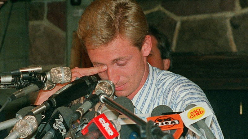 Wayne Gretzky wipes away tears during a press conference to announce his being traded from the Edmonton Oilers to the Los Angeles Kings at a press conference in Edmonton on August 9, 1988. (Ray Giguere / THE CANADIAN PRESS)