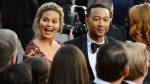 Chrissy Teigen, left, and John Legend arrive at the Oscars on Sunday, Feb. 28, 2016. (Photo by Al Powers/Invision/AP)