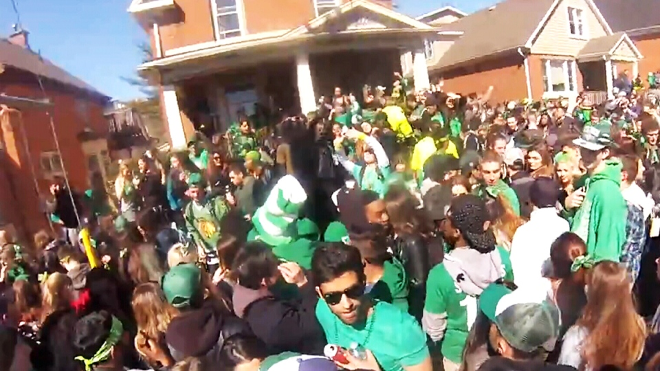 A crowd fills Ezra Street in Waterloo on March 17, 2015.