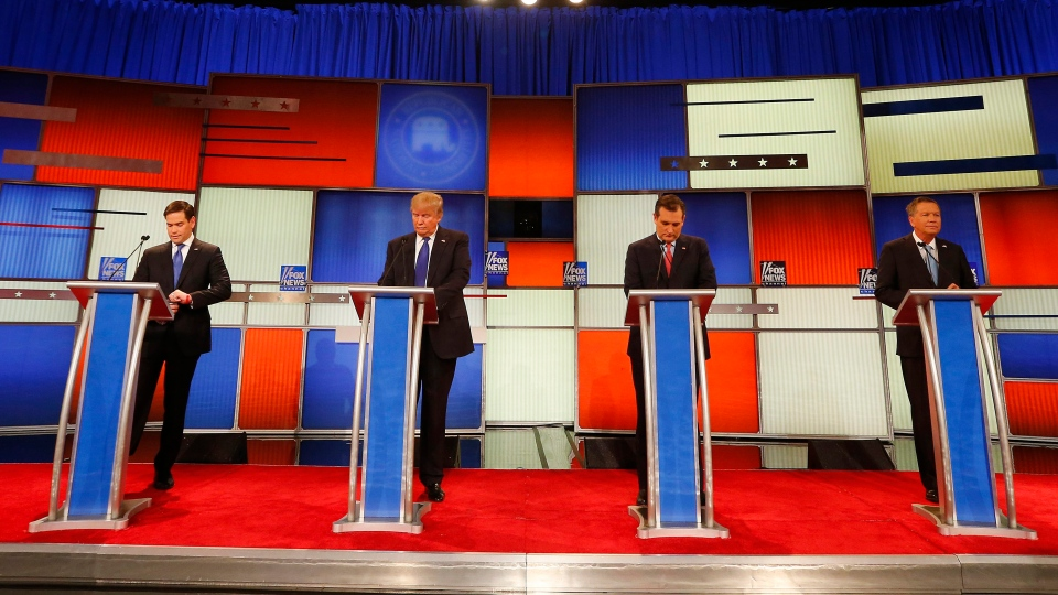 Republican presidential candidates, Sen. Marco Rubio, businessman Donald Trump, Sen. Ted Cruz and Ohio Gov. John Kasich wait before a presidential primary debate at Fox Theatre, in Detroit, on Thursday, March 3, 2016. (AP Photo/Paul Sancya)