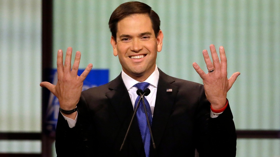 Republican presidential candidate, Sen. Marco Rubio, gestures during a debate at Fox Theatre, in Detroit, on Thursday, March 3, 2016. (AP Photo/Carlos Osorio)
