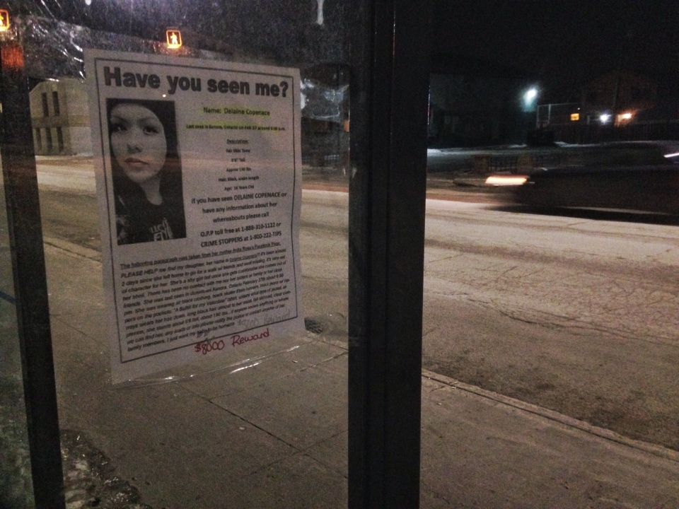 Volunteers with the Bear Clan citizen patrol hung posters in Winnipeg's North End Thursday night, advertising an $8,000 reward for tips that lead to Delaine Copenace.