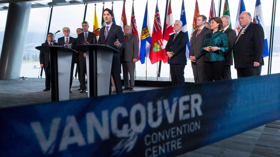 Prime Minister Justin Trudeau, centre, addresses the media during a news conference following the First Ministers Meeting in Vancouver, Thursday, March 3, 2016. (Jonathan Hayward / THE CANADIAN PRESS)