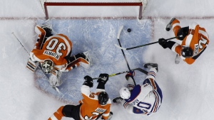 Edmonton Oilers' Nail Yakupov scores a goal against Philadelphia Flyers' Michal Neuvirth, Radko Gudas and Michael Raffl during the first period of an NHL hockey game, in Philadelphia on Thursday, March 3, 2016. (AP / Matt Slocum)