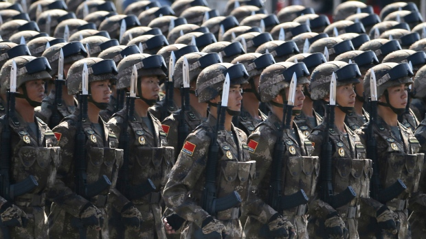 China to slightly boost military spending