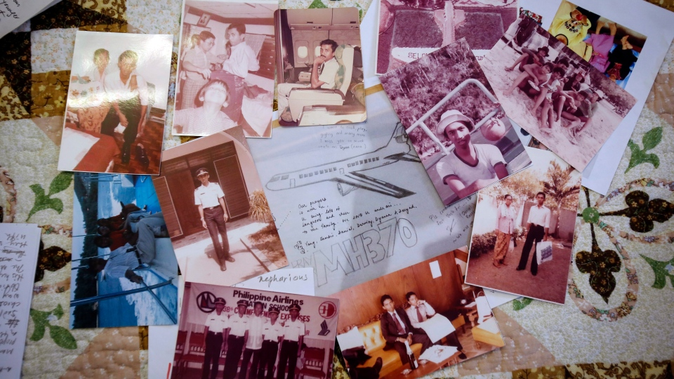 In this Feb. 28, 2016, photo, a collection of photos belonging to Captain Zaharie Ahmad Shah, the senior pilot of Malaysian Flight 370 that mysteriously vanished two years ago, is displayed at the house of his eldest sister, Sakinab Shah during an interview in Kuala Lumpur, Malaysia. (AP Photo/Joshua Paul)