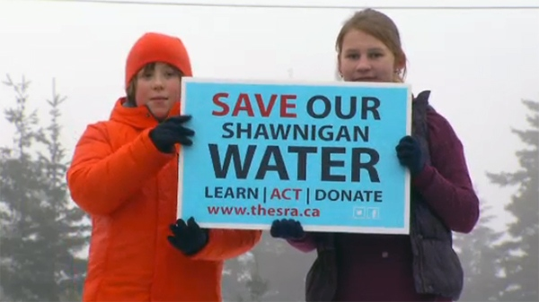 Two of the hundreds of protesters who gathered at Shawnigan Lake in January to voice their opposition to the soil dumping site near their watershed. (W5)