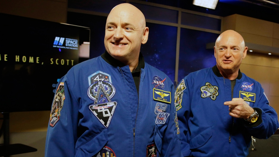 NASA astronaut Scott Kelly, left, and his twin Mark before a press conference  in Houston, on March 4, 2016. (Pat Sullivan / AP)