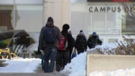 Students walk on the Waterloo campus of Wilfrid Laurier University on Friday, March 4, 2016.