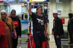 American adventurer Blaine Gibson, center, waves as he arrives at the Kuala Lumpur International Airport in Sepang, Malaysia, Saturday, March 5, 2016. (AP/Joshua Paul)