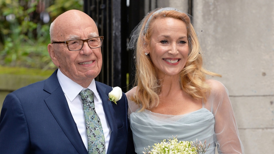 Media proprietor Rupert Murdoch and Jerry Hall pose outside St Bride's Church in London for a ceremony to celebrate their wedding, Saturday March 5, 2016. (John Stillwell / PA via AP)