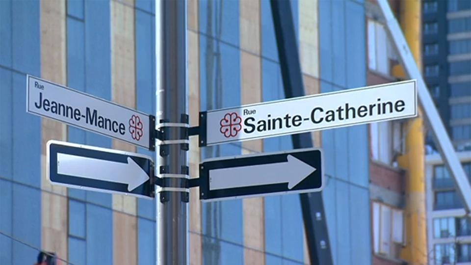 Street signs mark the corner of Rue Jeanne-Mance and Rue Sainte-Catherine in Montreal, Que.