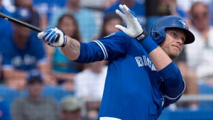 Toronto Blue Jays Michael Saunders watches his three run homer soar over the fence during first inning spring training action against the Philadelphia Phillies in Dunedin, FLa., on March 5, 2016. (Frank Gunn / The Canadian Press)