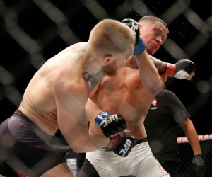 Nate Diaz, right, punches Conor McGregor during their UFC 196 welterweight mixed martial arts match, Saturday, March 5, 2016, in Las Vegas. (AP/Eric Jamison)