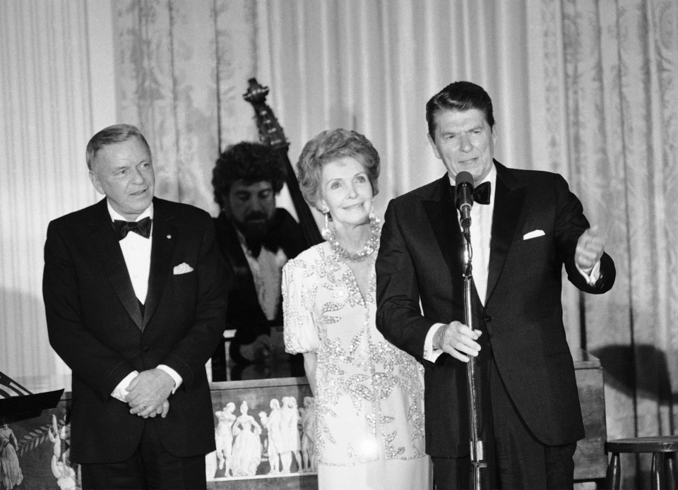In this June 19, 1984, file photo President Ronald Reagan and his wife Nancy Reagan address a White House State Dinner audience. (AP/Scott Stewart, FILE)