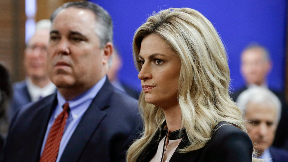 Sportscaster and television host Erin Andrews, right, stands with attorney Scott Carr, left, as they wait for the jury to enter the courtroom before closing arguments Friday, March 4, 2016, in Nashville, Tenn. (AP / Mark Humphrey, Pool)