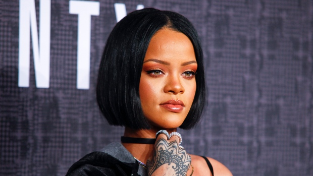 "In this Feb. 12, 2016 file photo, Rihanna attends the JFENTY PUMA by Rihanna fashion show in New York. Rihanna is one of a few celebrities who are responding or ""clapping back"" to unflattering comments on social media. (Photo by Andy Kropa/Invision/AP, File)"
