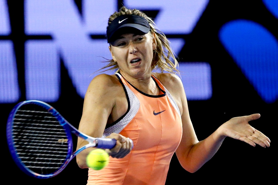 In this Jan. 20, 2016, file photo, Maria Sharapova, of Russia, hits a forehand return to Aliaksandra Sasnovich, of Belarus, during their second-round match at the Australian Open tennis championships in Melbourne, Australia. (Vincent Thian / AP Photo)