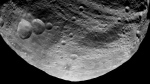 In this image released by NASA/JPL on Thursday July 28,2011 shows an image of the dark side of Vesta asteroid captured by NASA'S Dawn spacecraft on July 23, 2011, and taken from a distance of about 3,200 miles (5,200 kilometers) away from the giant asteroid. (AP Photo/NASA/JPL)