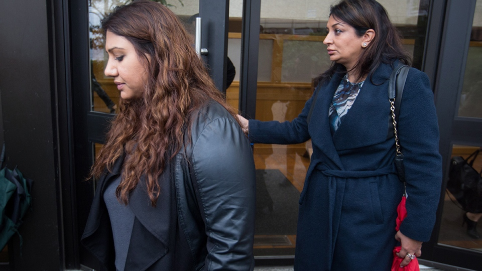 Maple Batalia's sister Roseleen Batalia, left, leaves B.C. Supreme Court after Gurjinder 'Gary' Dhaliwal was sentenced to life in prison with no eligibility of parole for 21-years in relation to her sister's death, in New Westminster, B.C., on Monday, March 7, 2016. (Darryl Dyck / THE CANADIAN PRESS)