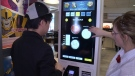 Alfred Wong gets a demonstration of a new self-help kiosk at the McDonald's on St. Laurent Blvd. in Ottawa, March 7, 2016