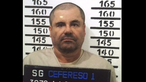 """In this Jan. 8, 2016, file image released by Mexico's federal government, Mexico's most wanted drug lord, Joaquin """"El Chapo"""" Guzman, stands for his prison mug shot with the inmate number 3870 at the Altiplano maximum security federal prison in Almoloya, Mexico. (Mexico's federal government via AP)"""