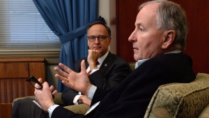 Conservative MP Rob Nicholson, right, and Liberal MP Rob Oliphant take part in an interview on Parliament Hill in Ottawa, on Friday, Feb. 26, 2016. (THE CANADIAN PRESS/Sean Kilpatrick)